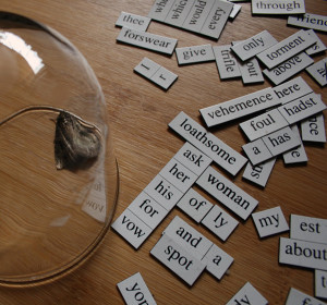 Glass with magnetic poetry